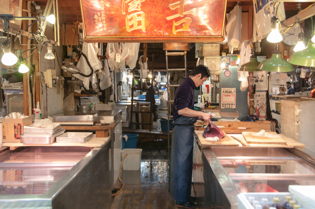 A Man Filets a Fresh Blue Fin Tuna