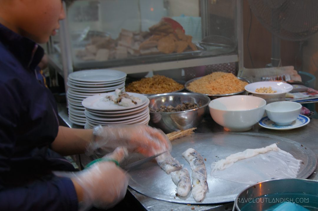 Northern Vietnamese Street Food - Woman making bahn cuon in Hanoi