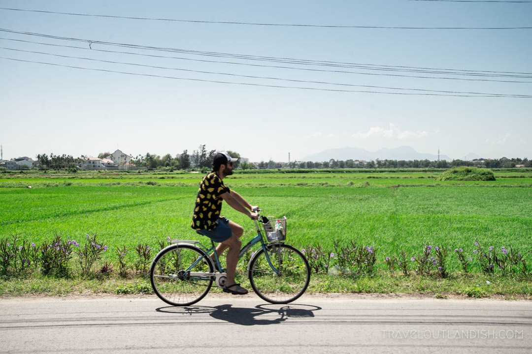 Jake Cycling beside the Rice Patties in Hoi An