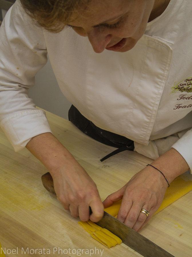 Cutting the dough into wider tagliatelle pasta