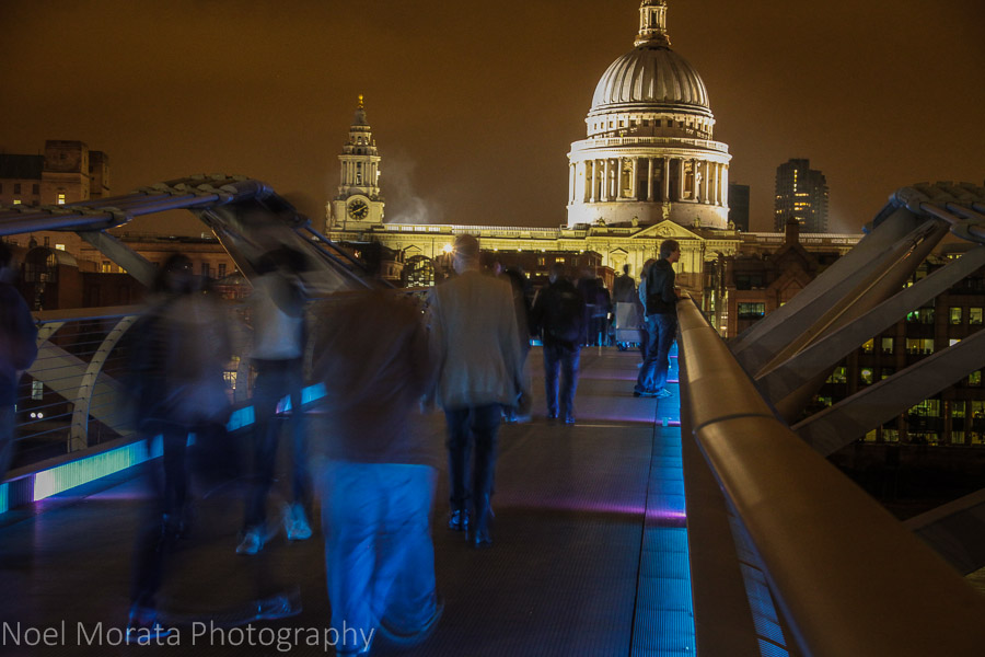 Walking through the Millennium bridge to St Paul's Cathedral