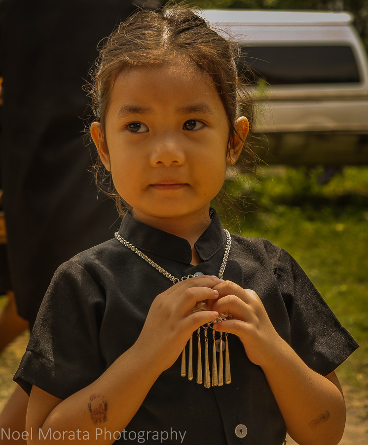 Beautiful smiles and local jewelry of the Ta Dam people