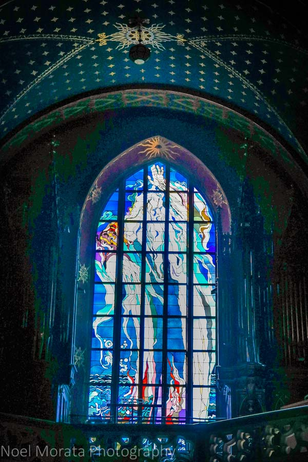 A lit up stained glass panel at a monastery in Krakow