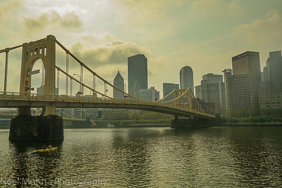 Iconic yellow suspension bridge and downtown PIttsburgh