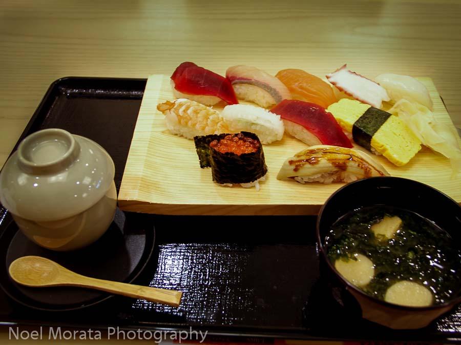 Trying fresh sushi in Dotonbori, Osaka