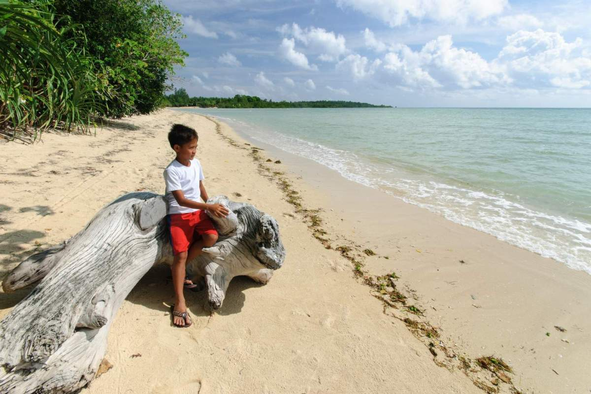Cagbalete Island Marco striking a pose near the estuary