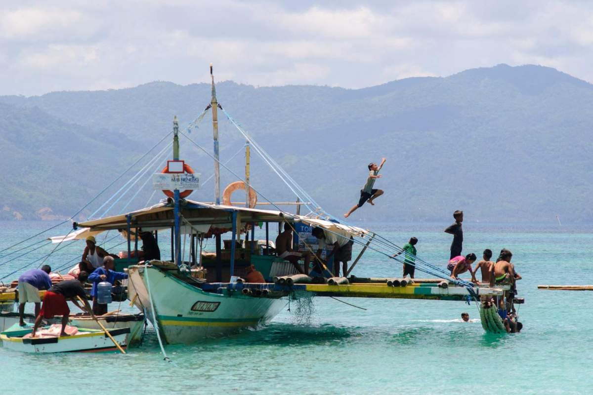 Cagbalete Island Children playing on M/B Neneng prior to our boarding