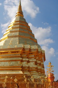 The prominent gold chedi at the temple at the top of Doi Suthep in Chiang Mai, Thailand