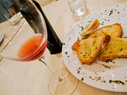 Wine, bread, and fresh olive oil on a wine tasting in Florence, Italy.