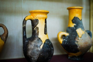Beautiful small pieces of pottery inside the museum at the Amman Citadel, Jordan.