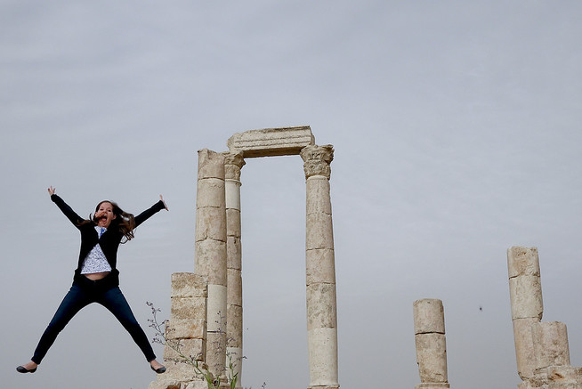 Jodi from Legal Nomads jumps at the Amman Citadel in Jordan
