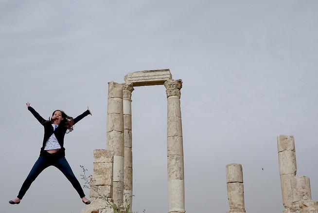 Jodi from Legal Nomads jumps at the Amman Citadel in Jordan
