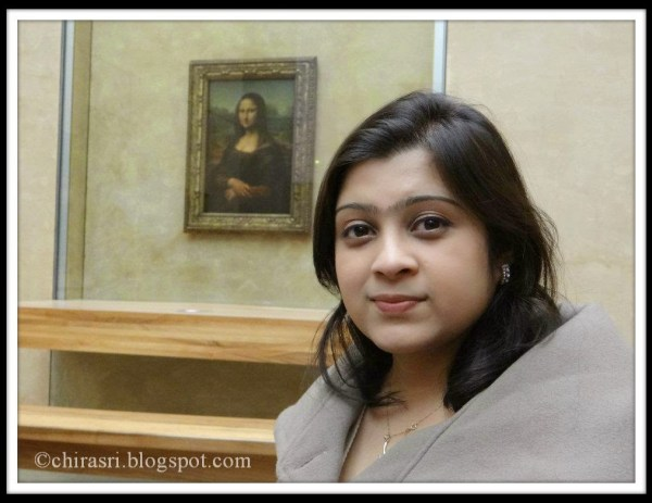 In front of Mona Lisa in Louvre