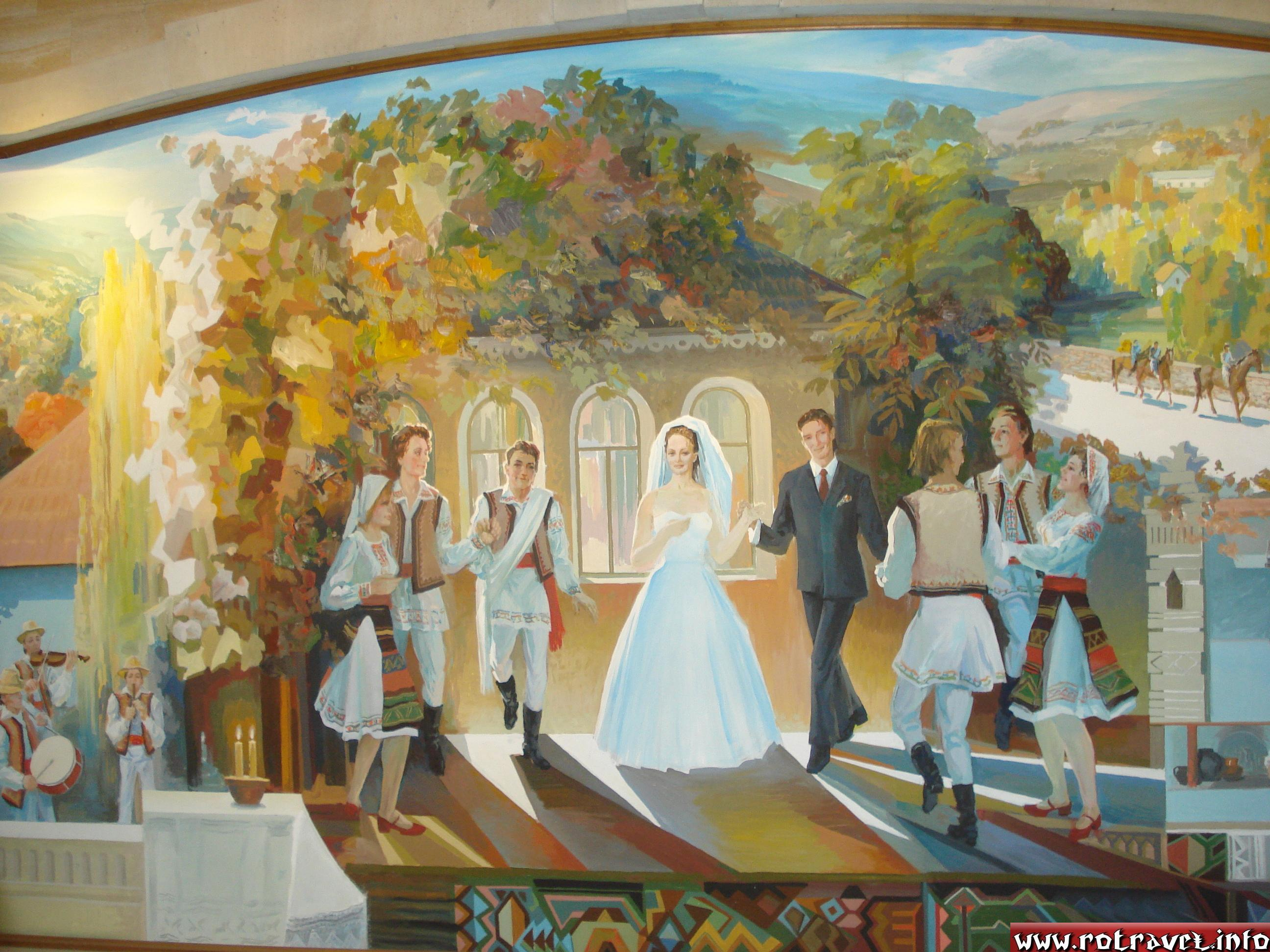 "A picture of ""Moldavian wedding"" painted on a wall."
