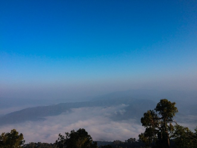 Clouds gather in the valley below for an unforgettable experience