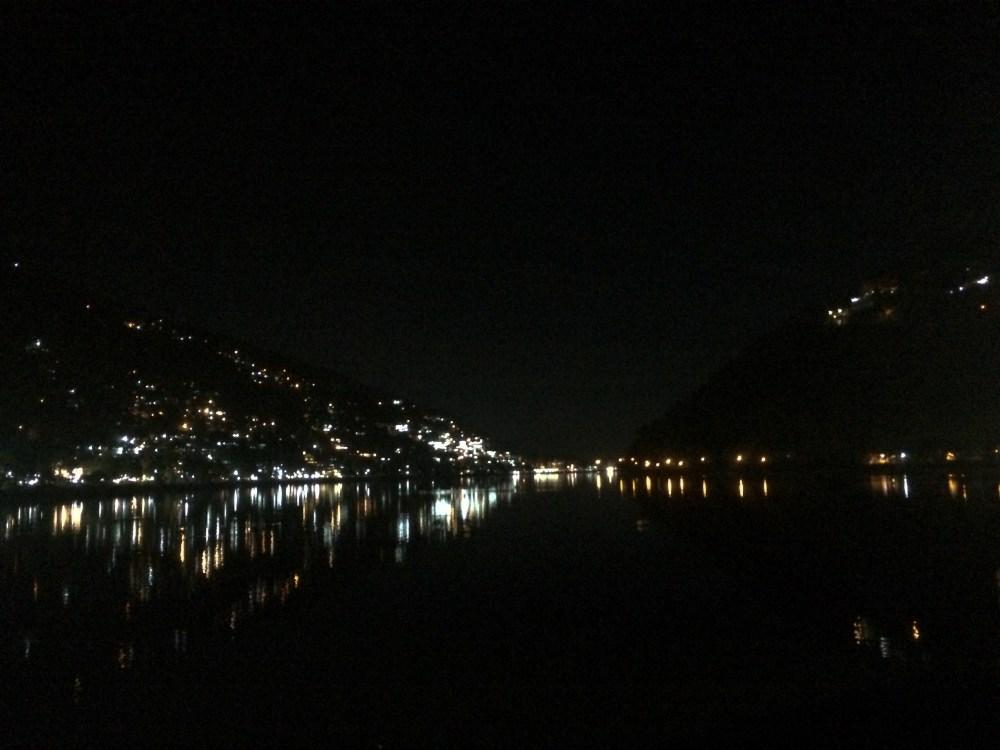 Night lights twinkle on the lake