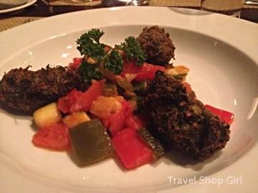 Spinach beignets with okra ratatouille and tomato concassé