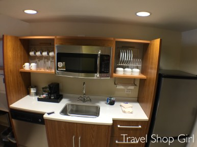 1 Queen Bed Studio kitchen area at Home2Suites Denver West