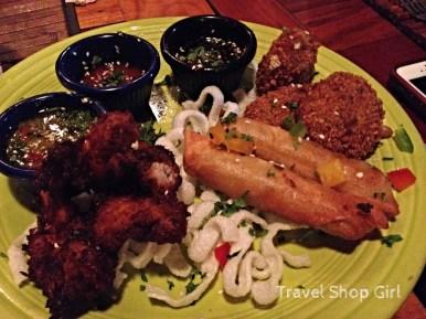 Coconut Shrimp, Filipino pork lumpia, and lemongrass tofu cakes