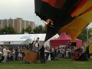 A balloon at the european balloon festival is inflated. Here is an action shot as the operators activate the burners to heat the air.