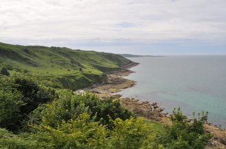 The coast of Normandy. If you don't like green, don't go there.