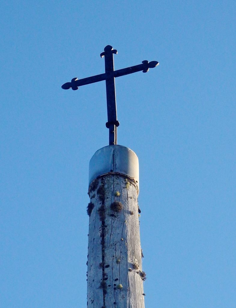 Cruz de Ferro...Pilgrims bring a stone or meaningful object from home to leave at the cross. It signifies laying down burdens before receiving a blessing in Santiago. (Photo by Suzanne Ball. All rights reserved.)