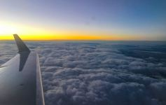 Frequent flyer miles-Plane wing at dawn
