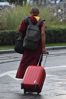 Solo Travel Safety-packing light allows you to get where you're going without stress. Can you duplicate this monk's packing style? (Photo Credit: Pixabay)