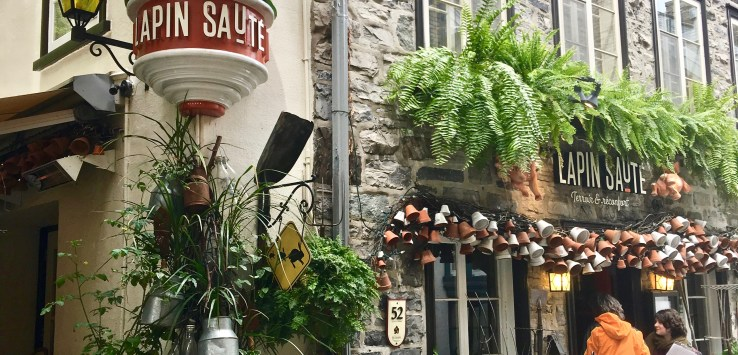 """Quebec City: In the """"Lower Town,"""" restaurant Lapin Saute (Jumping Rabbit) occupies an old house and lovely adjacent garden. (Photo by Suzanne Ball. All rights reserved.)"""