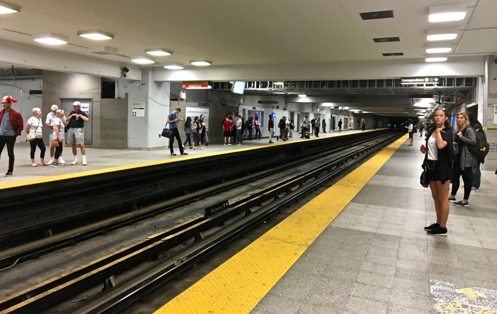 Metro Subway: Once you find your platform, pick a place and wait for the train. Always stay behind the yellow or safety line. (Photo by Suzanne Ball. All rights reserved.)