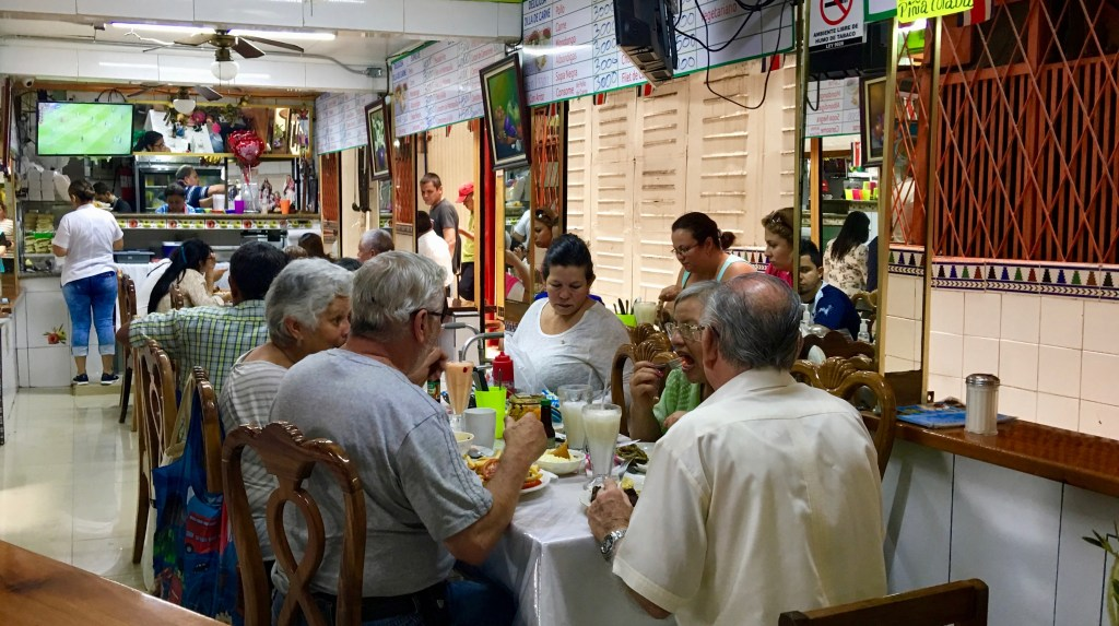 Ticos value time with family more than anything else. Here they enjoy lunch together at the Central Market in San Jose.