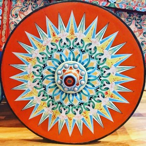 Oxcart wheels are often painted in bright colors and decorated with intricate designs.
