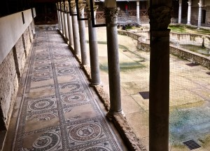 The quadrangular peristyle has mosaics of 162 animal heads, each surrounded by a laurel crown, leaves, and birds.
