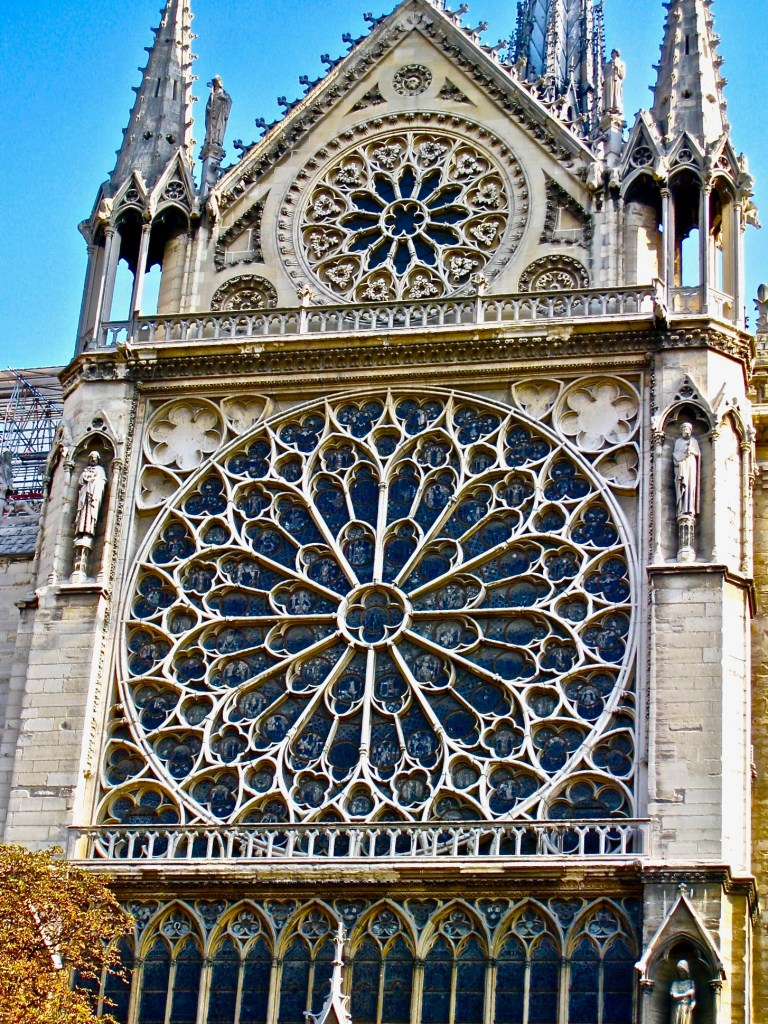 The Rose Window still holds stained glass from Medieval artists. Thankfully, it was spared.