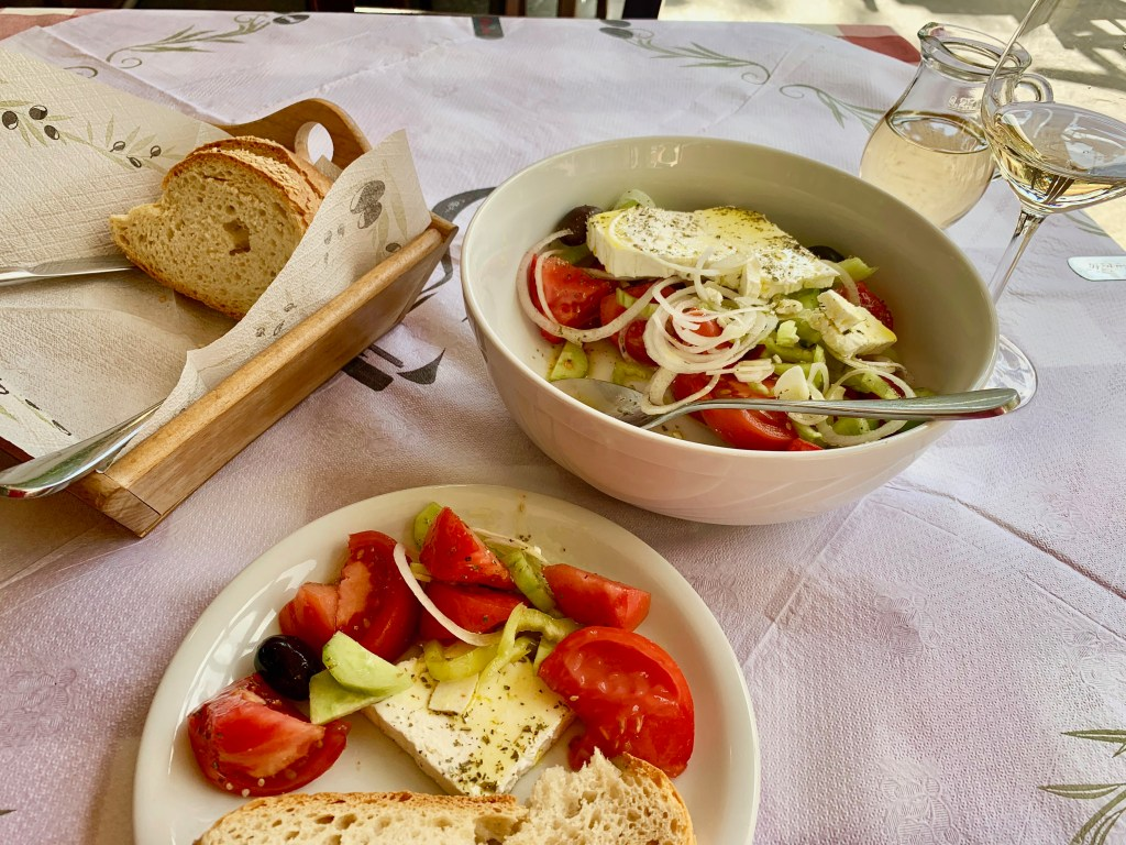 Greek salad, crusty bread, and a glass of wine...does it get any better?!?