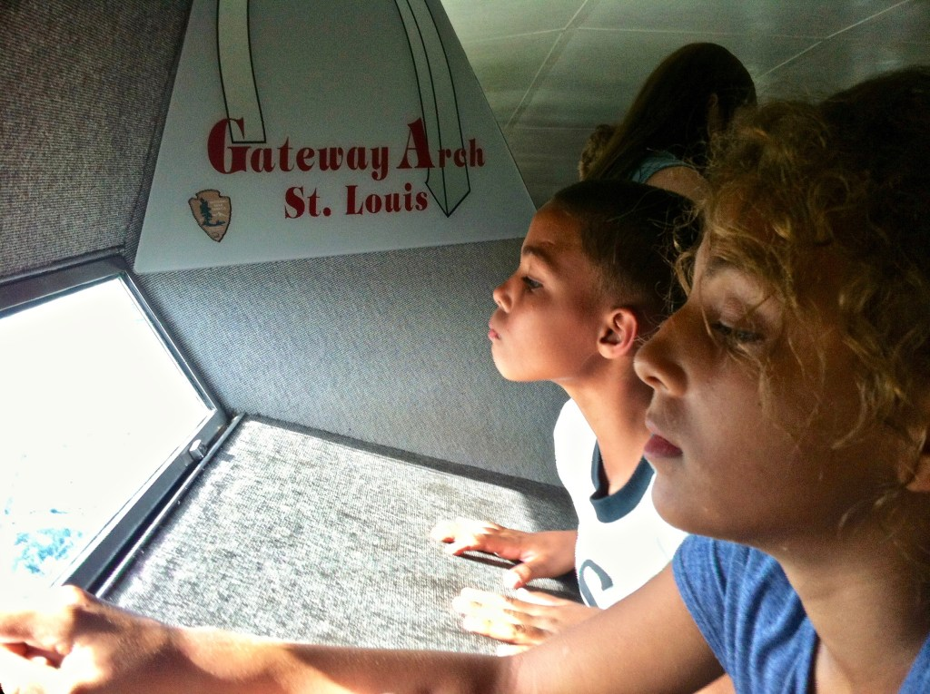 Turning kids into travelers means visiting famous landmarks. Here, we're at the top of the Arch in St. Louis. Even the ride up was a new adventure!