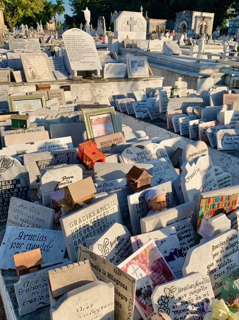 Today, the markers and tokens of gratitude  have spread to cover surrounding tombs.