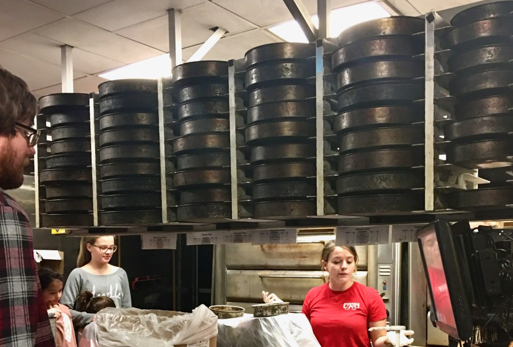 Pizza pans at Pizzeria UNO, waiting for orders.