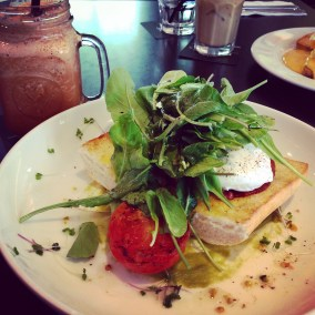 Poached eggs with avocado, bacon and rocket