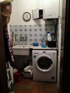 This is our tiny laundry room. In Italy, no one really owns a dryer. So we have lots of cleaning supplies and the washer in here.