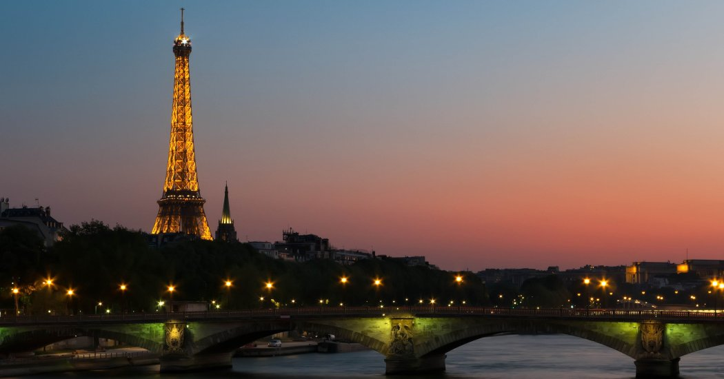 Nightfall in Paris infront of Eiffel tower