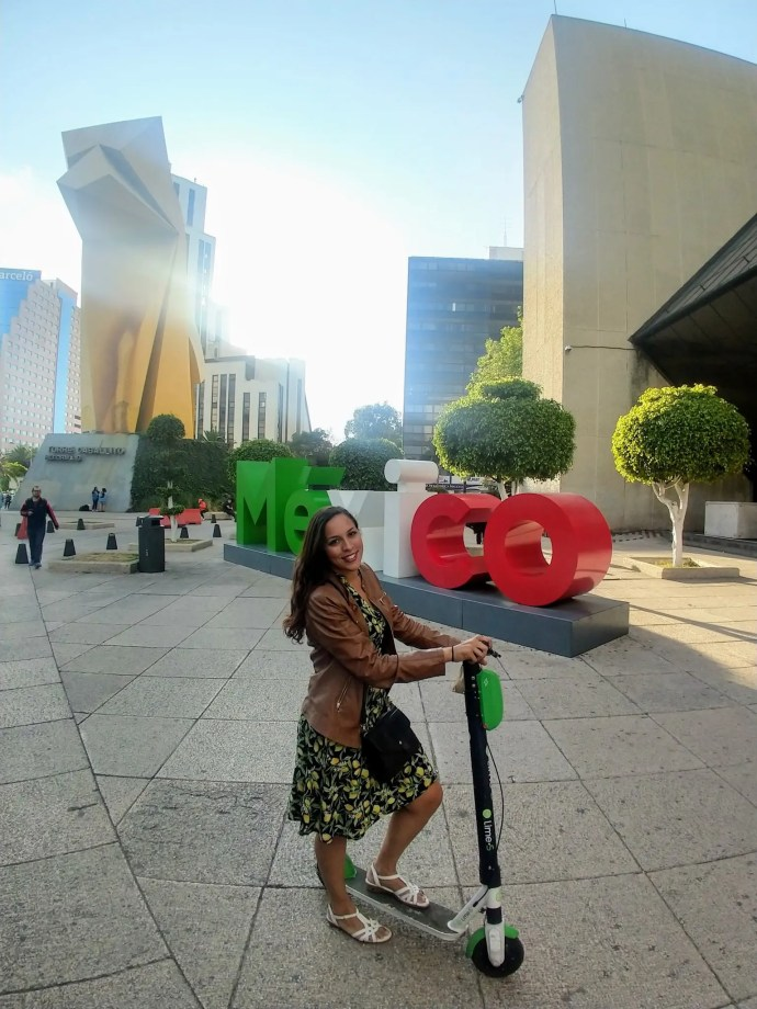 Lime Scooter preparing to scoot down Paseo De La Reforma avenue on a Sunday free ride in Mexico City.