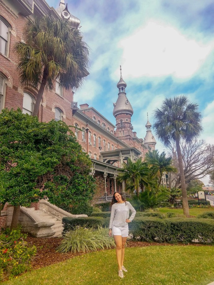 Sarah Fay Travel Blogger in front of University of South Florida in Tampa Florida.