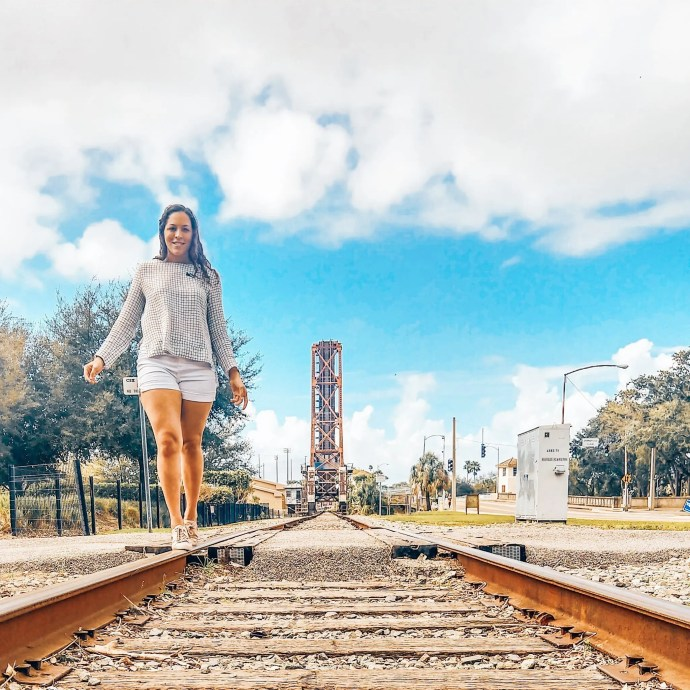 Sarah Fay walking on the old train bridge in downtown Tampa near the Riverwalk.