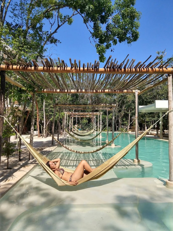 Sarah Fay travel blogger relaxing on a sunny day on a Hammock at Holistika Wellness hotel