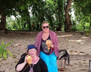 My friend, Di, and I enjoying a coconut on the beach (PNG)