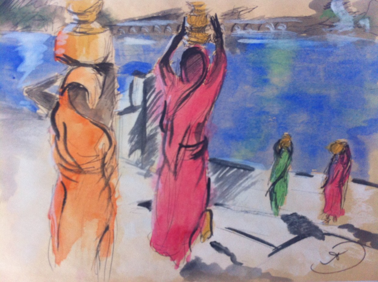 Women carrying water from Puskhar Lake in the early morning sun in Pushkar, Rajasthan, India.
