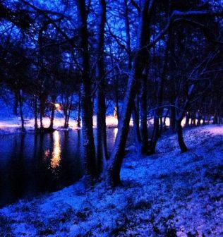 Snow in a blue light on Åkers Canal, Åkersberga, Sweden.