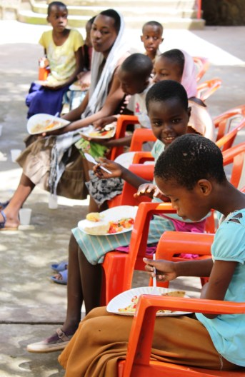 Students enjoying food at Isamilo International School's Saturday School Christmas Party.