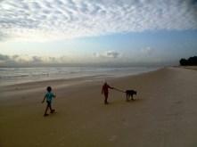 Frida and Lottie walking Piana along the beach, Dar Es Salaam